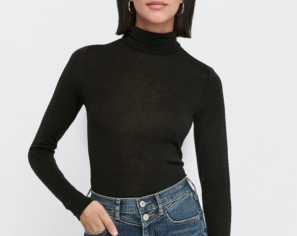 young woman in black turtleneck and jeans