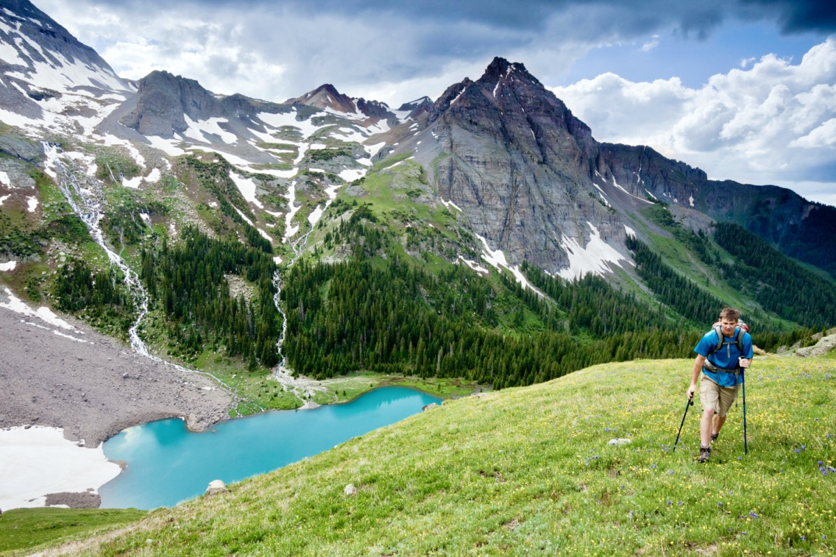 A hiker above lower Blue Lake near Ouray Colorado