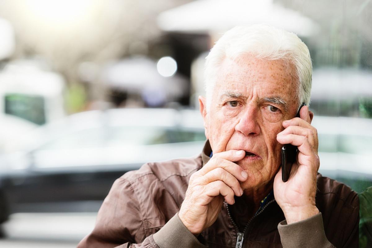 Man on phone looking worried