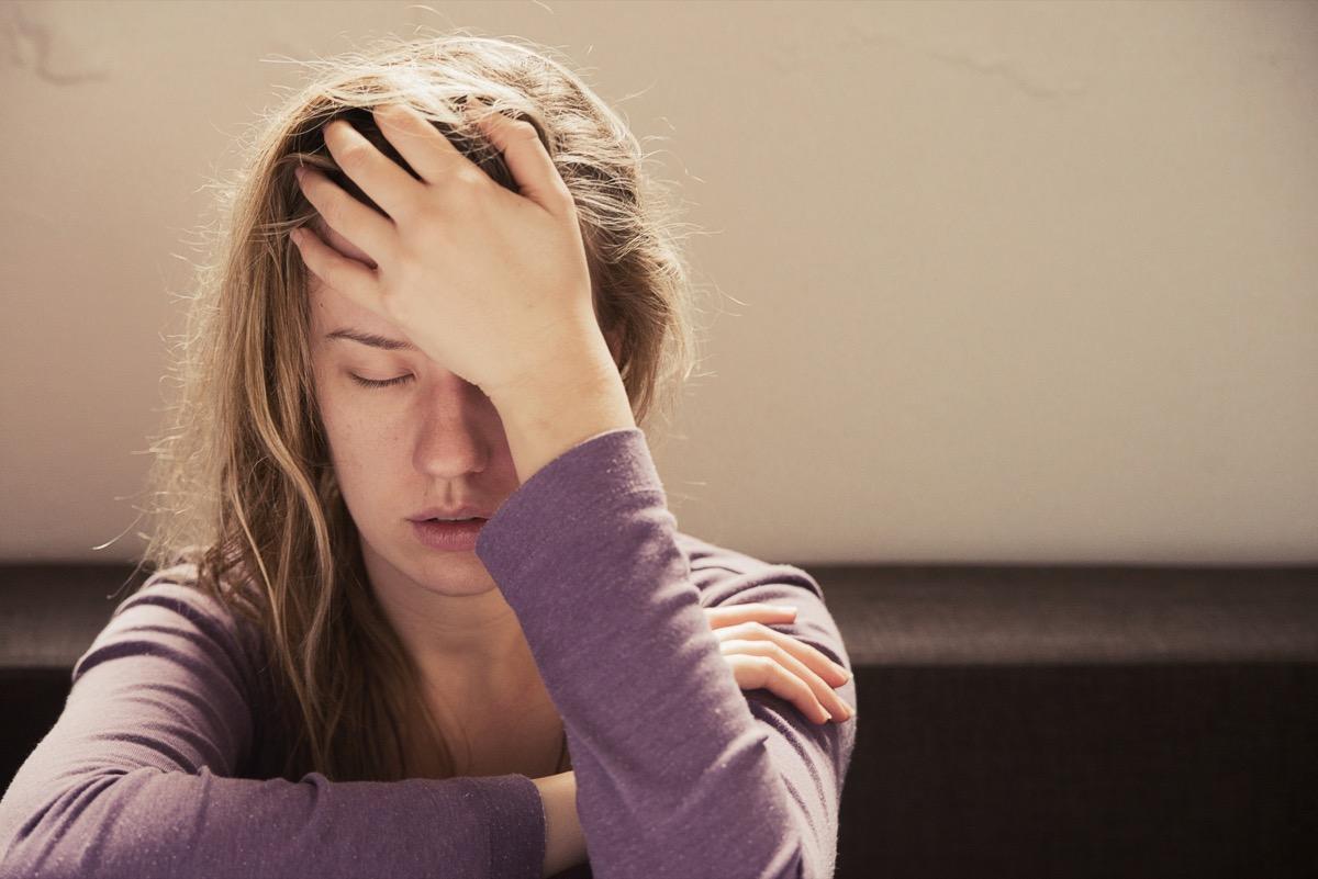 Woman feeling pressure on her brain in pain