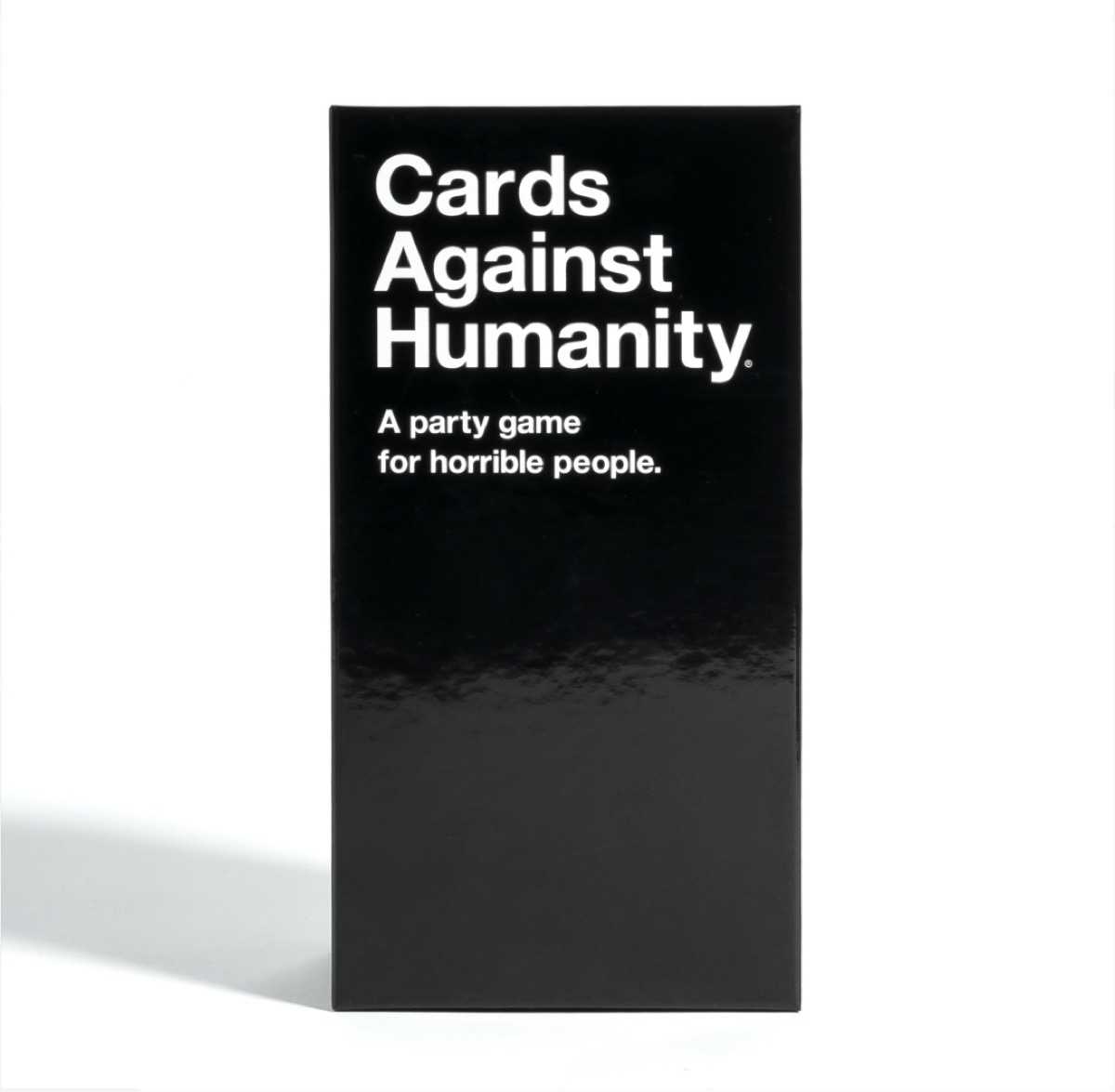 black box containing cards against humanity game