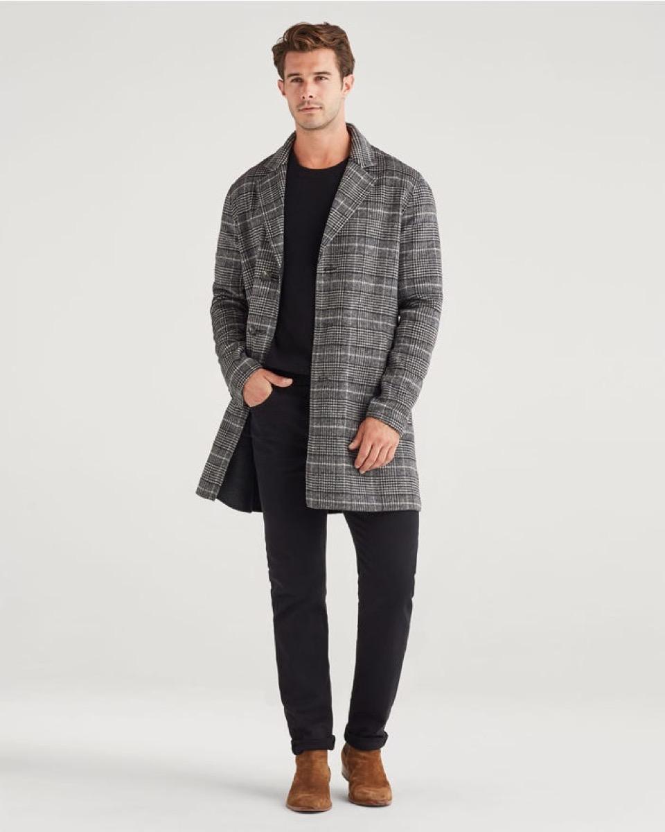 white guy in checked overcoat