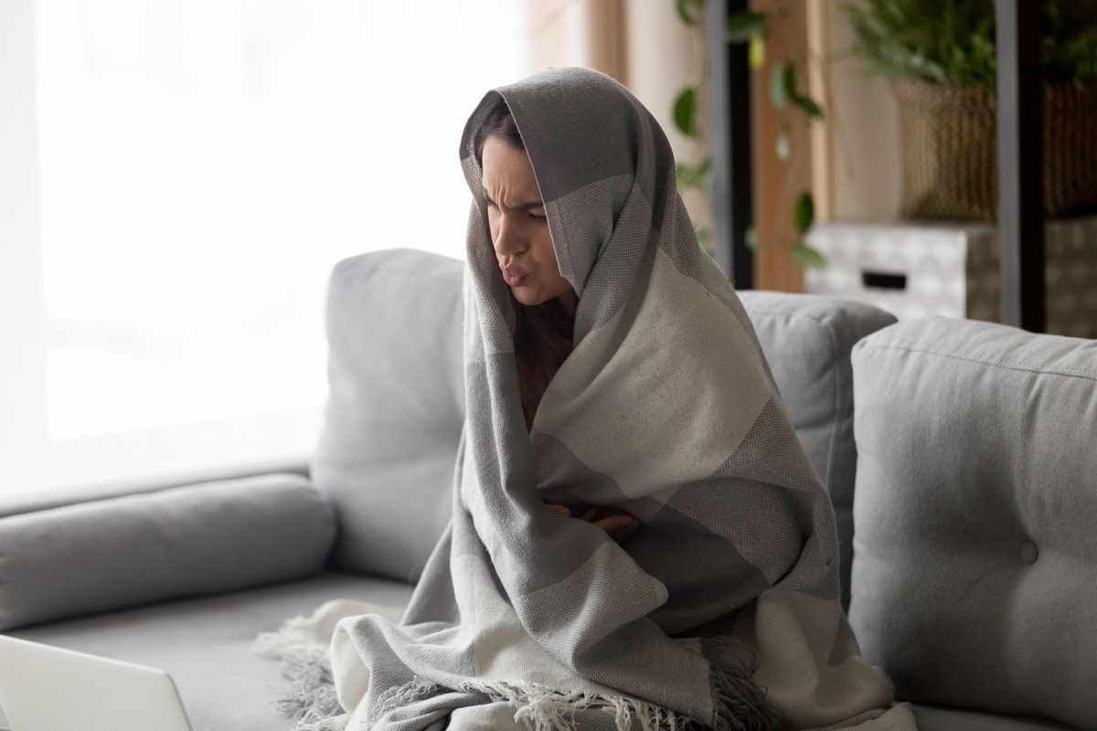 Woman swaddled in blanket with chills no fever