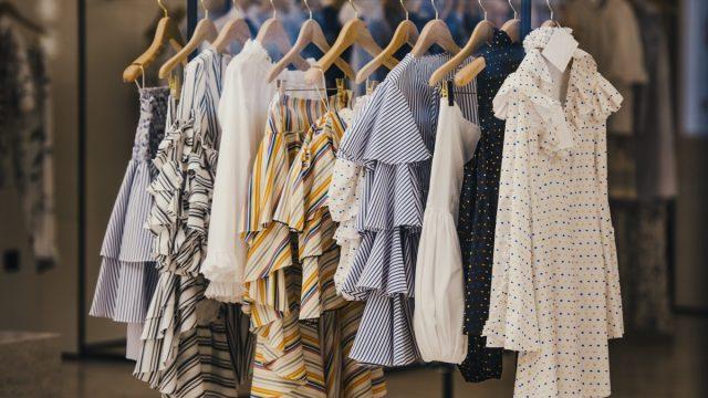 clothing rack full of fall fashion