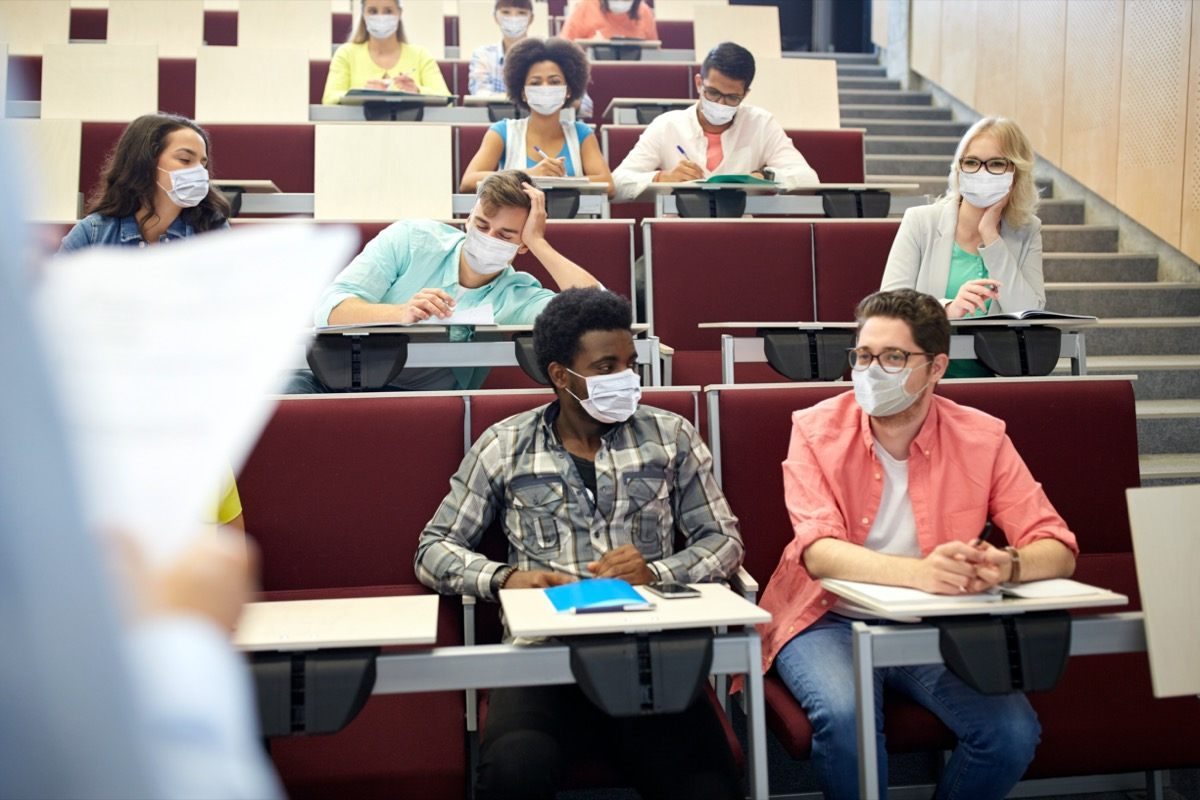 students wearing masks in college lecture hall