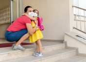Mother embraces her daughter on the first day of school amid coronavirus