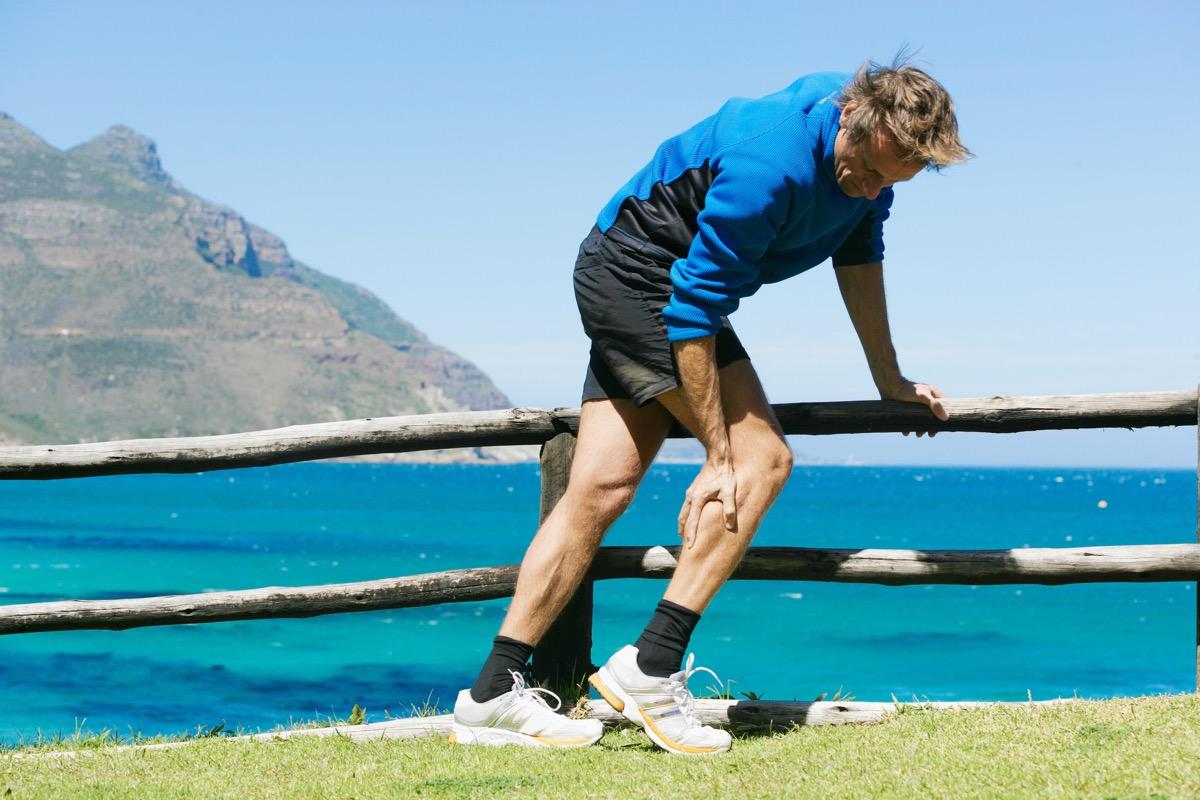 Man with calf cramp