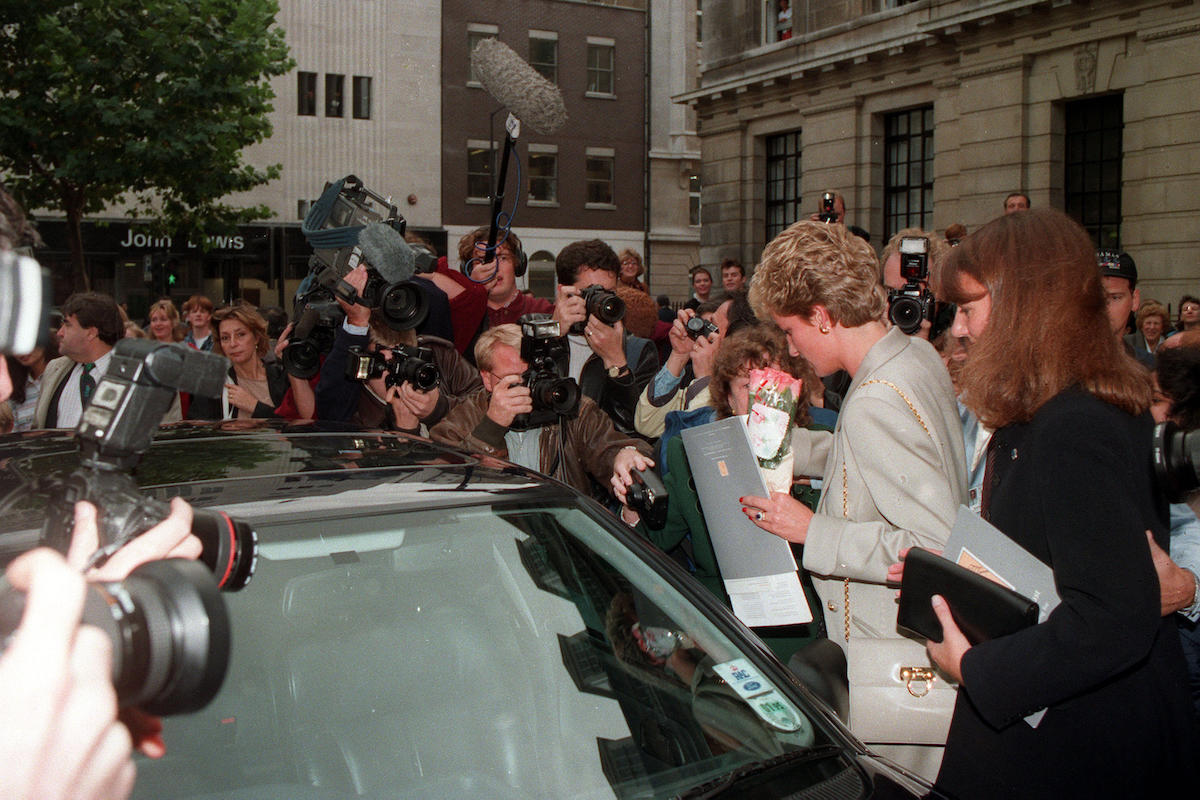 Princess of Wales being mobbed by photographers and wellwishers as she leaves the Royal College of Nursing in London's Cavendish Square with her friend Catherine Soames (right) after attending a launch of The Child Bereavment Trust.
