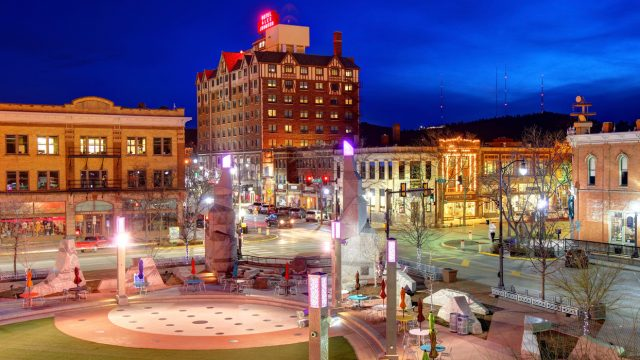 A view of Rapid City, South Dakota at night, with a park in the foreground.