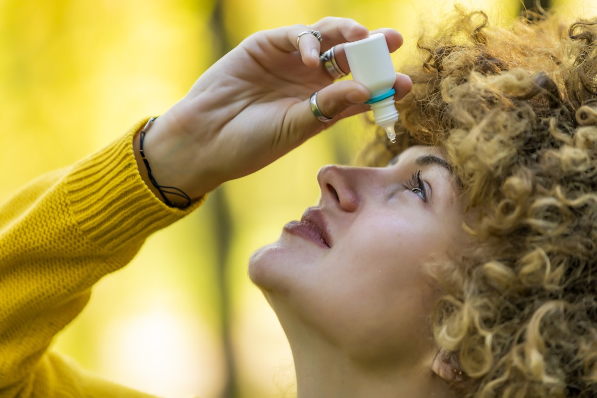 Woman putting eye drops in dry eyes