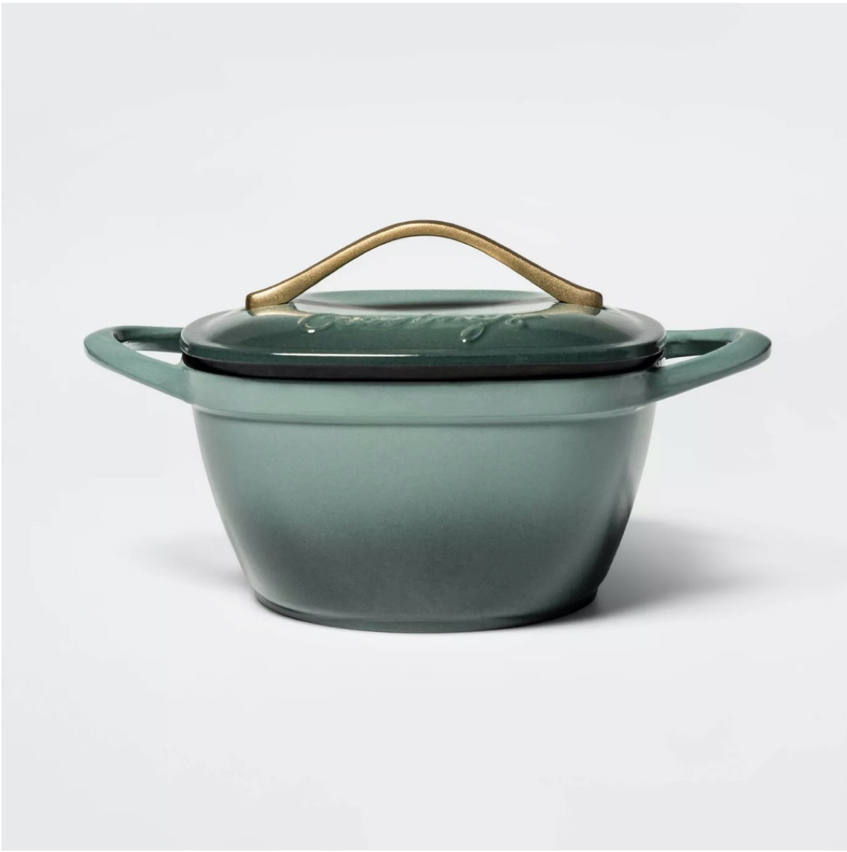 green dutch oven with handle