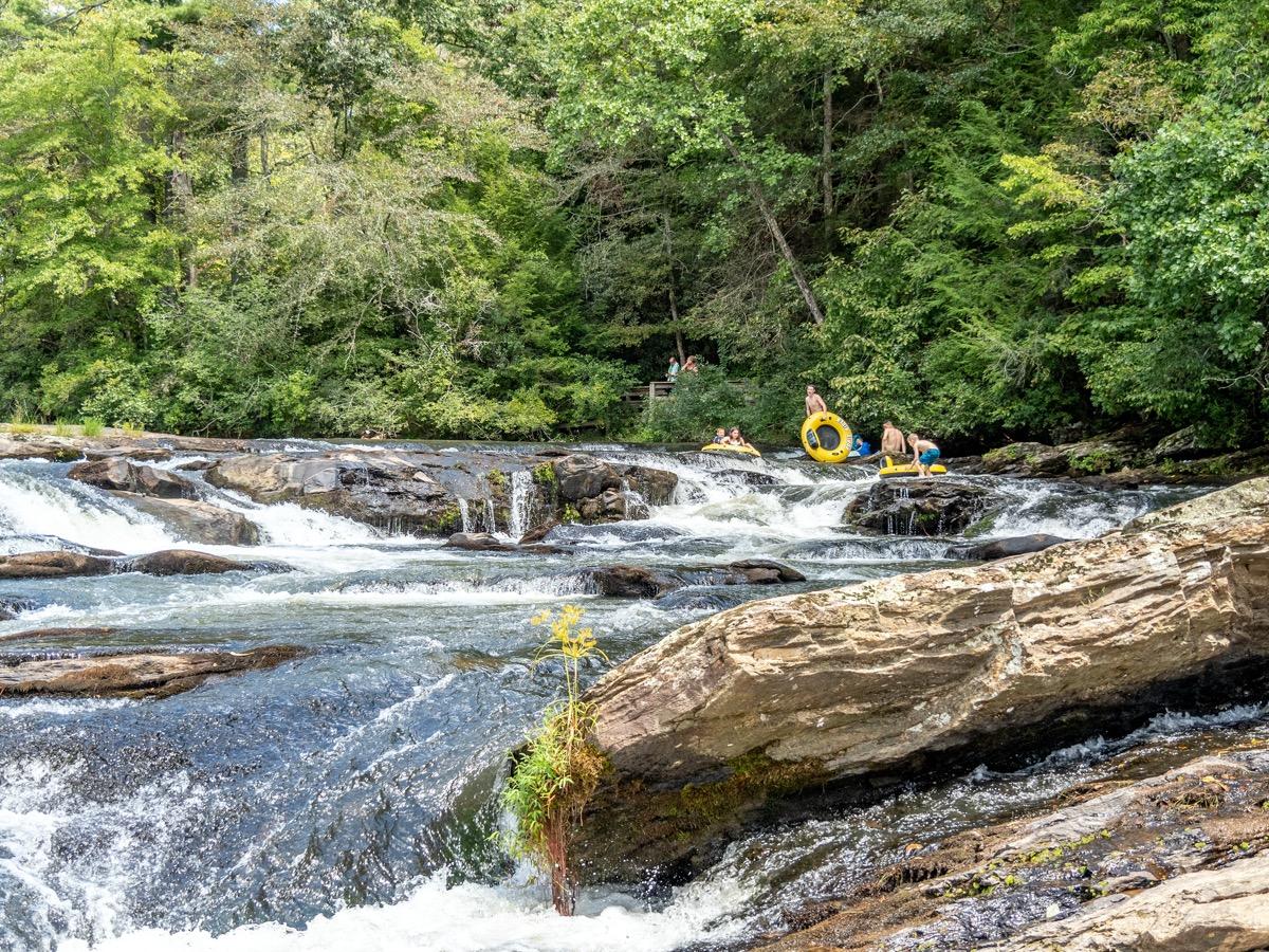 kids go tubing in a river in georgia