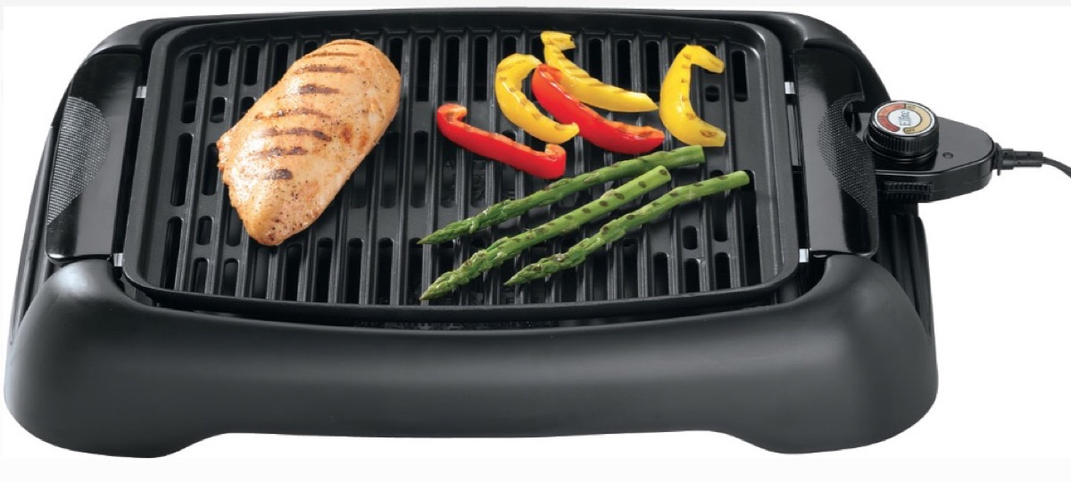 vegetables and chicken on black electric grill