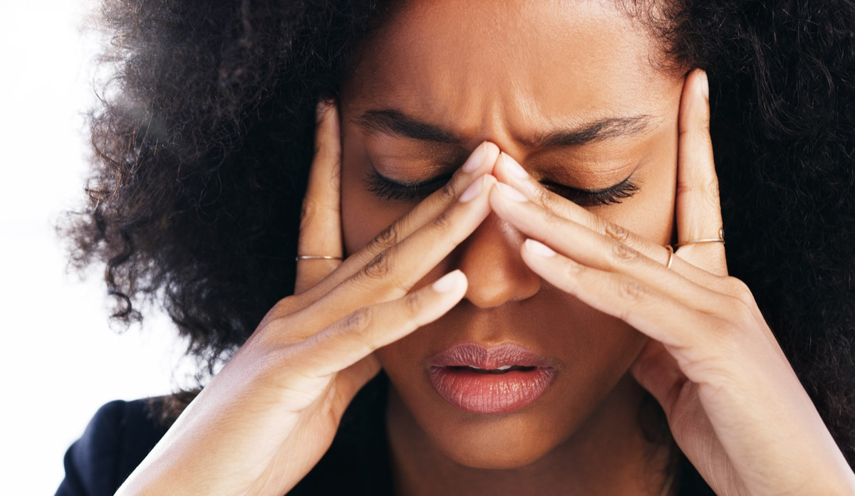 Woman rubbing eyes because of vision problems