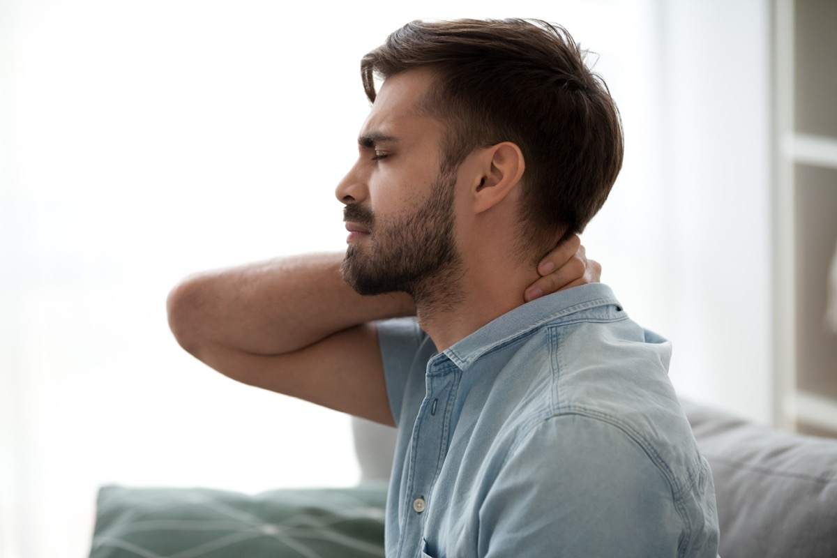 Man experiencing neck pain because of fibromyalgia