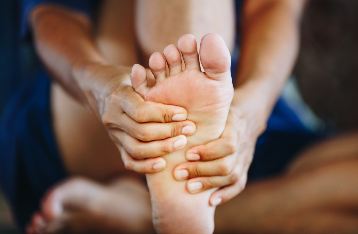 Massaging foot to get rid of pain