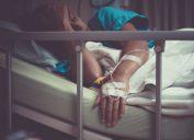 sick woman lying in bed in hospital.