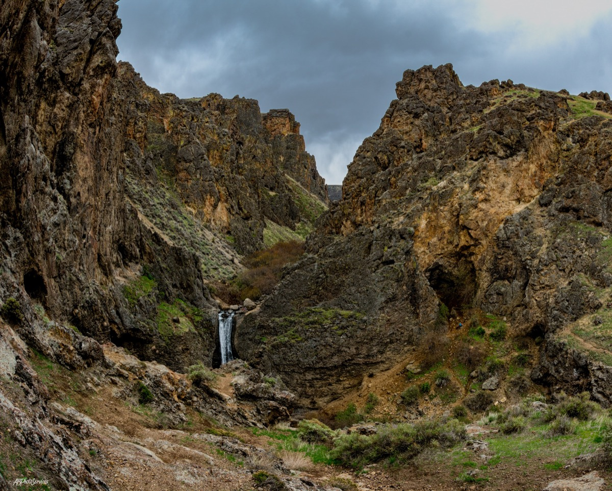 waterfall surrounded by canyons in idaho
