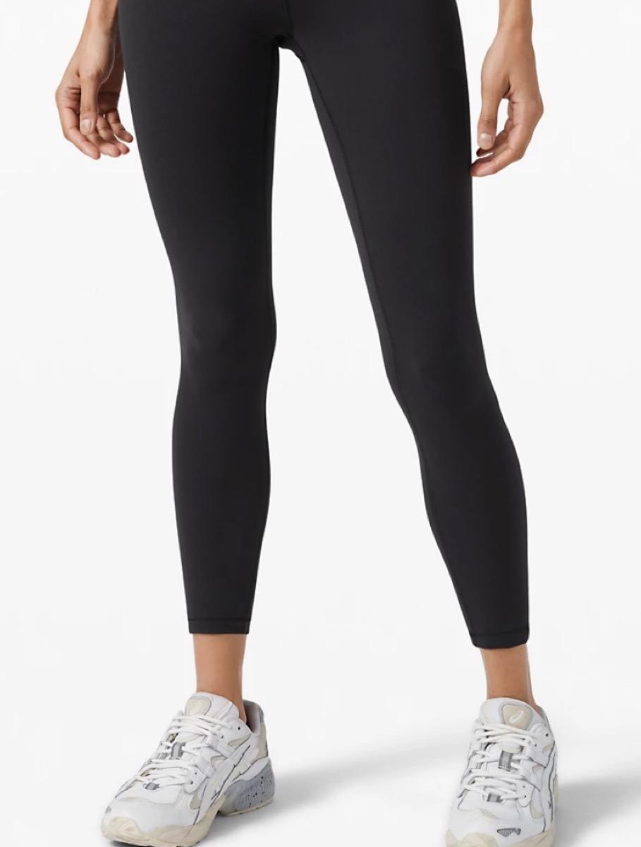 white woman in black leggints
