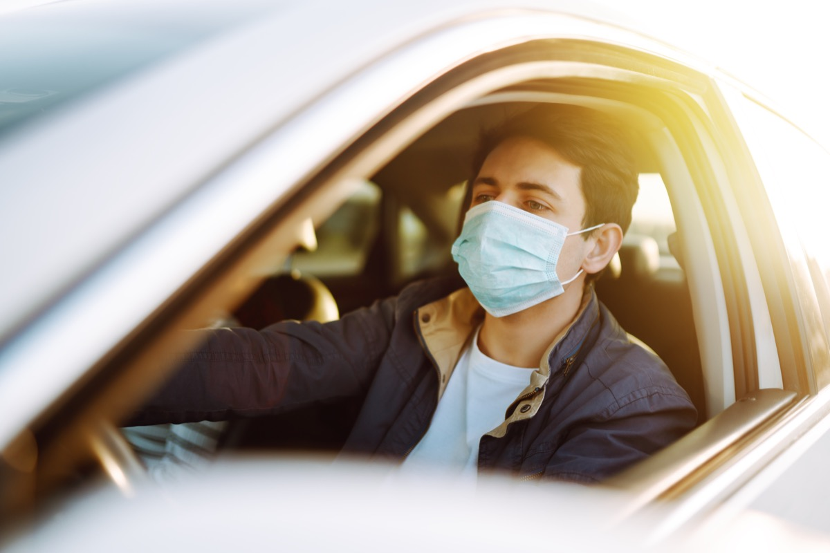 Man wearing mask in car