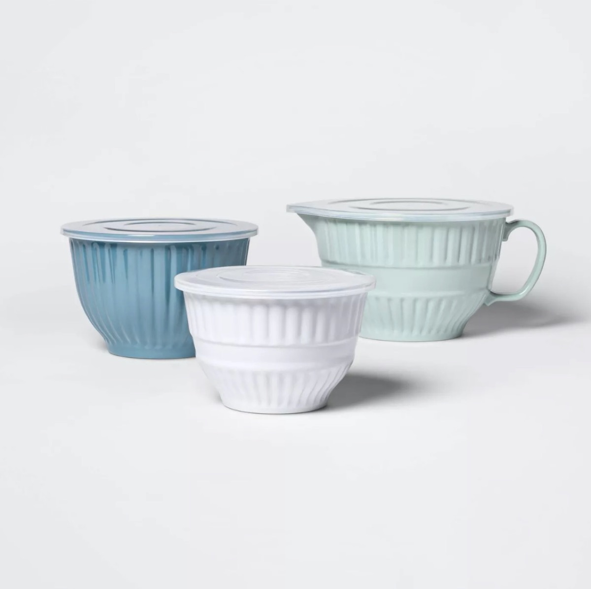 three ceramic bowls in shades of blue and white