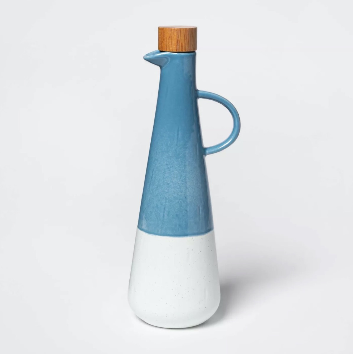 blue and white olive oil bottle with cork