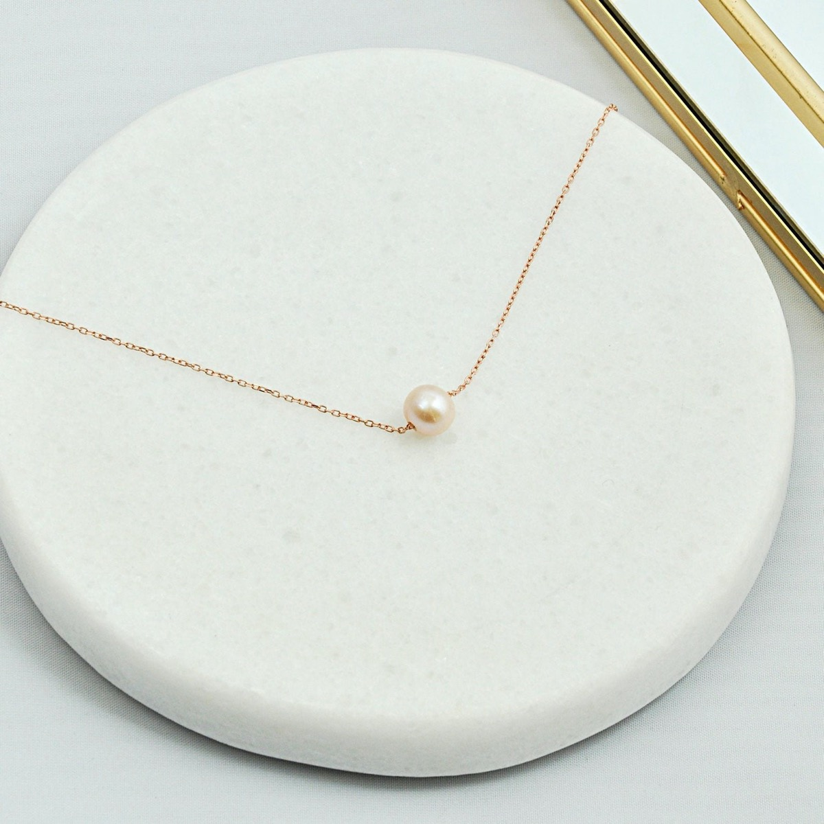 single pearl on a chain