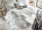 bedroom with white and gray comforter set with feather design
