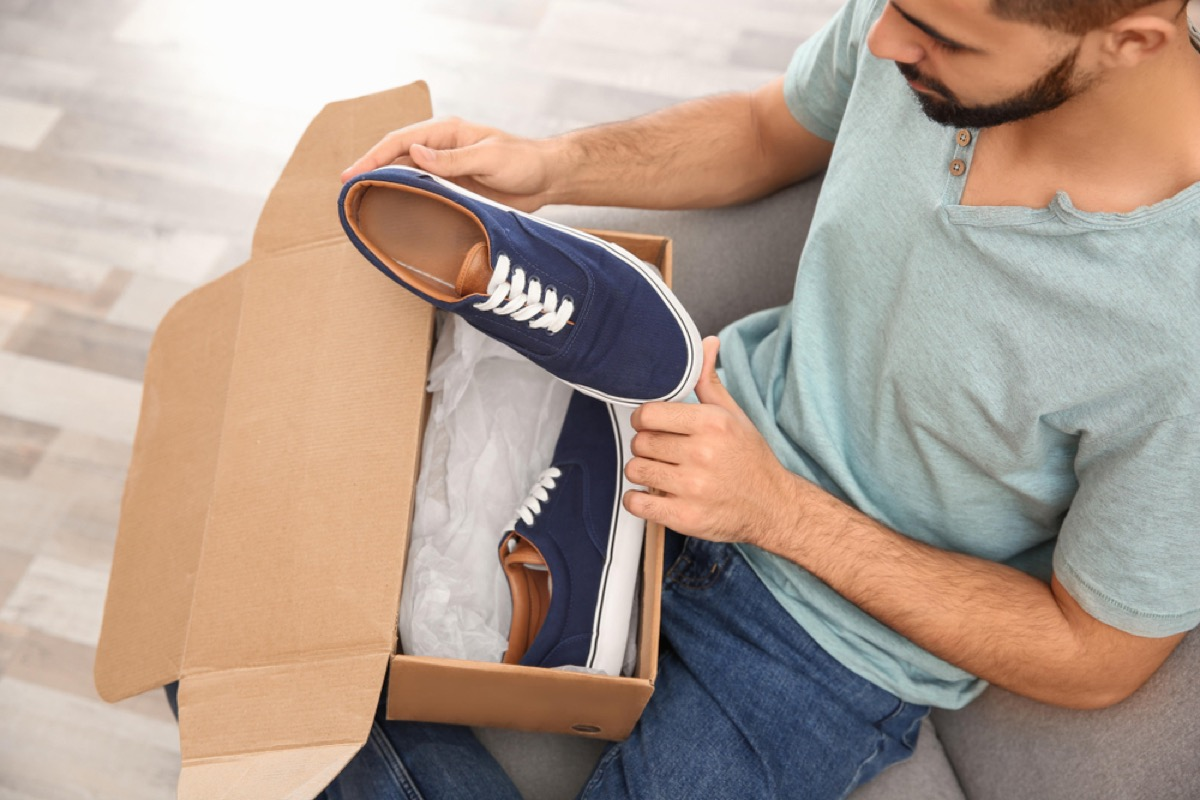 man taking shoes out of shoebox