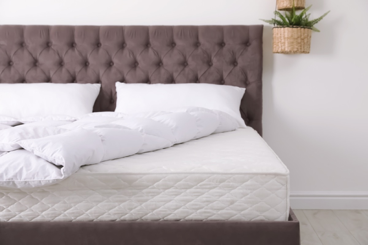 bare mattress on a bed