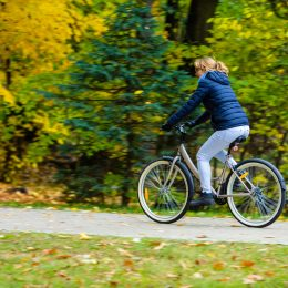 Woman riding a bike in the park