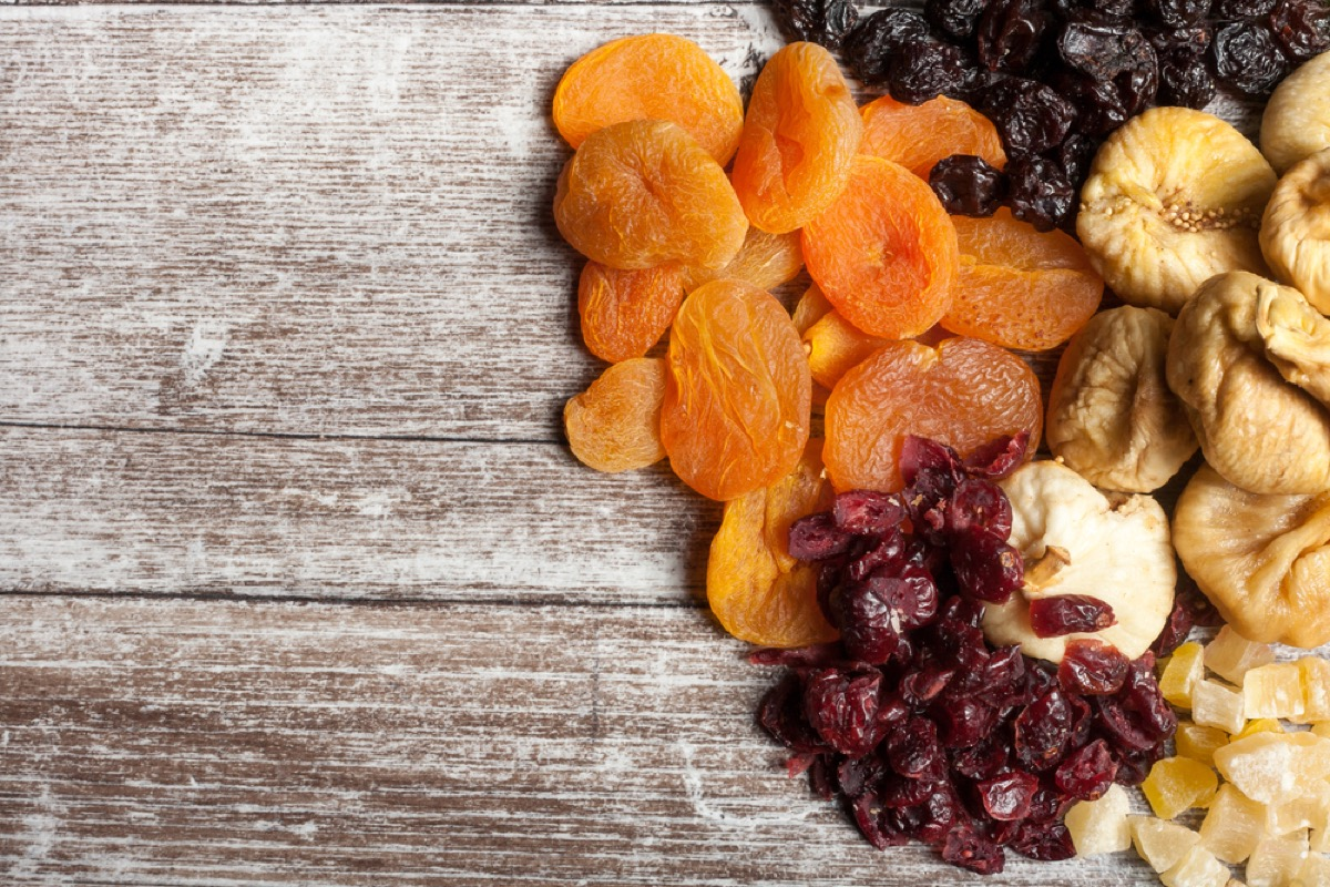 dried fruit and nuts on wood