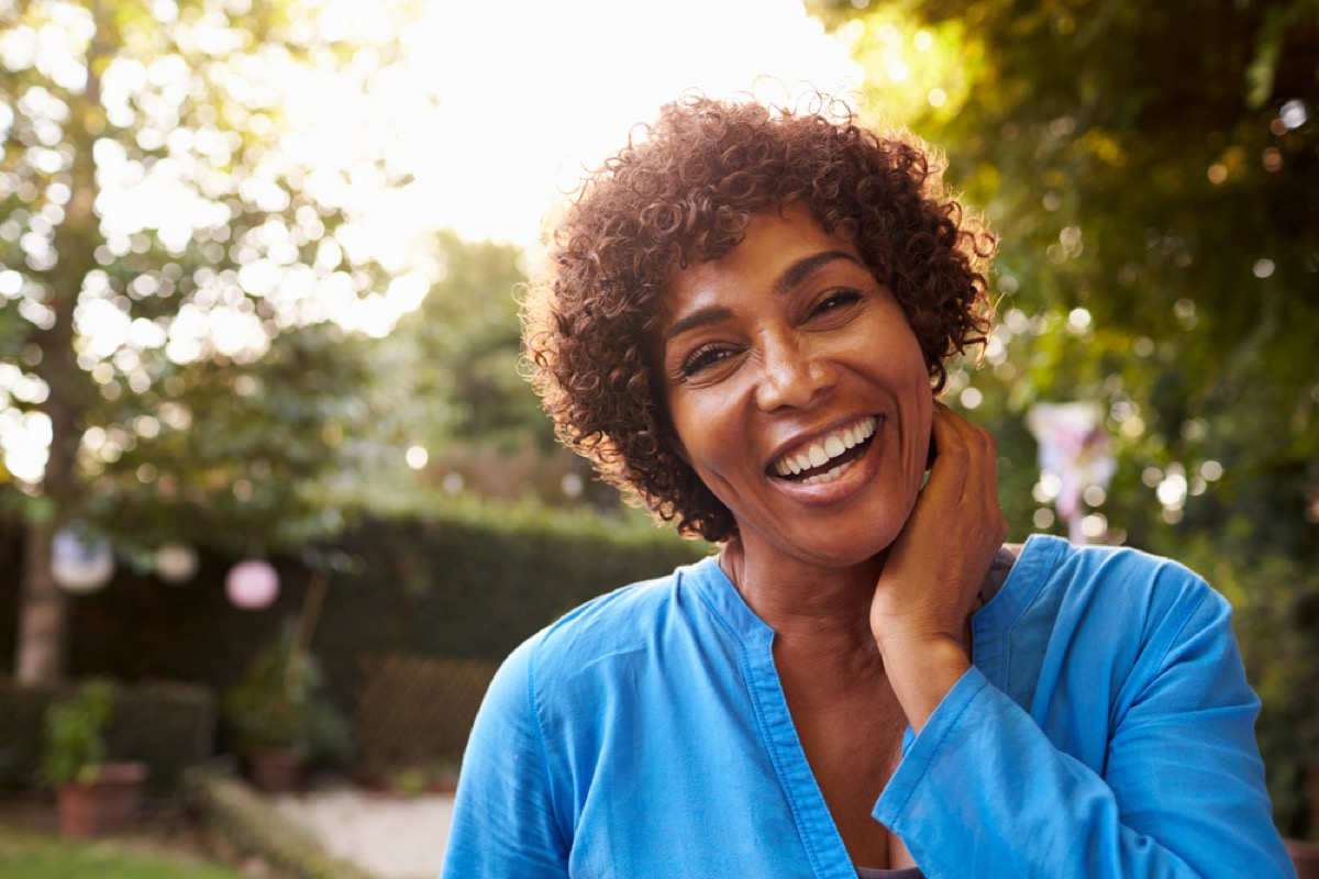 smiling black woman outside in the sun