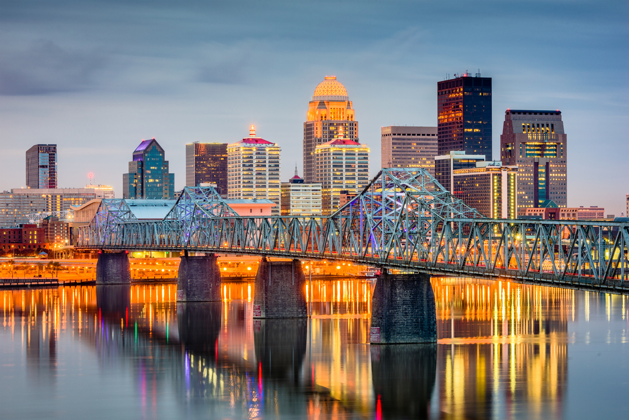 The skyline of Louisville, Kentucky with a blue bridge in the foreground