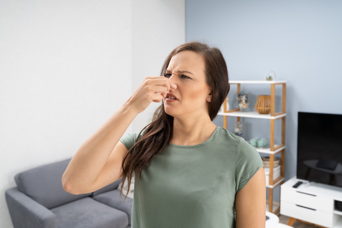 Woman Covering Her Nose From Bad Smell