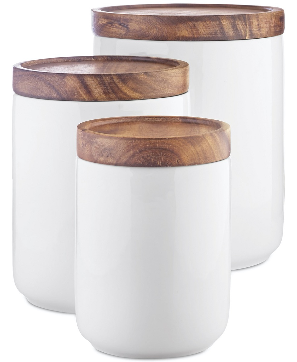 white canisters with wooden tops