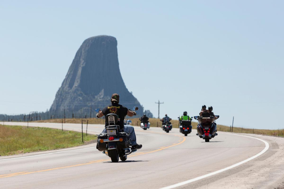 Bikers cruise along Highway 24 near Wyoming's Devils Tower on Friday, August 14, 2020. Every year, bikers who attend the nearby Sturgis Motorcycle Rally in South Dakota descend on the iconic landmark.