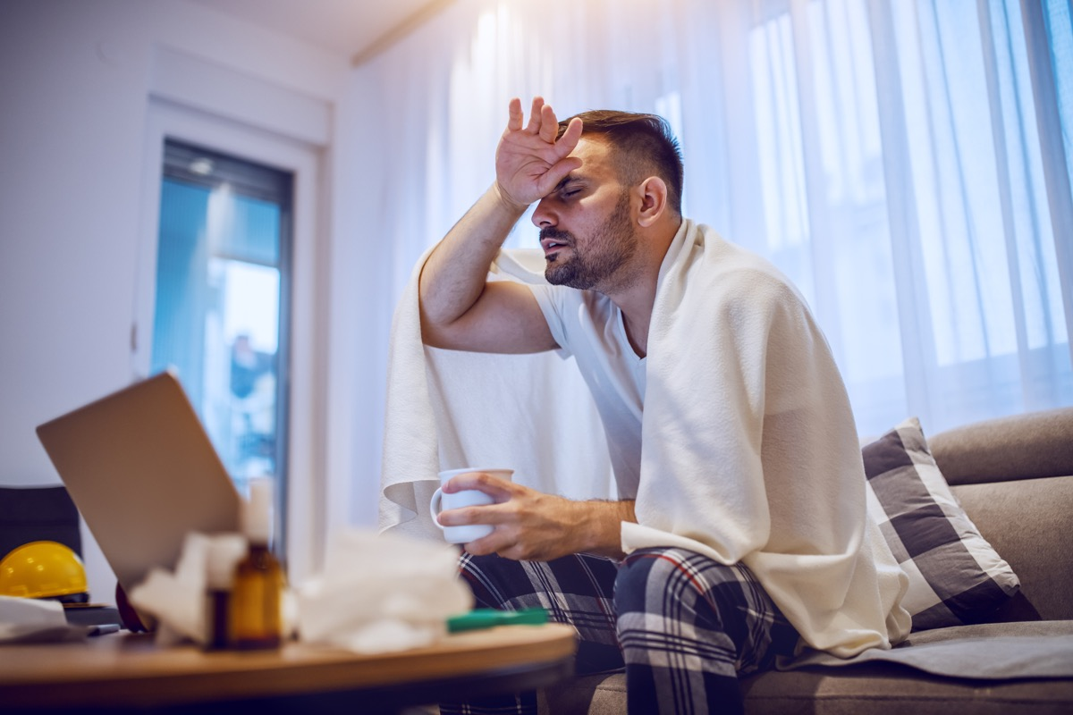 Man with fever and chills symptoms from covid