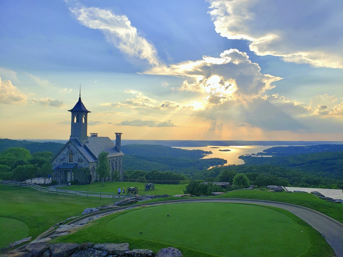 chapel of the ozarks at sunset overlooking table rock lake in missouri