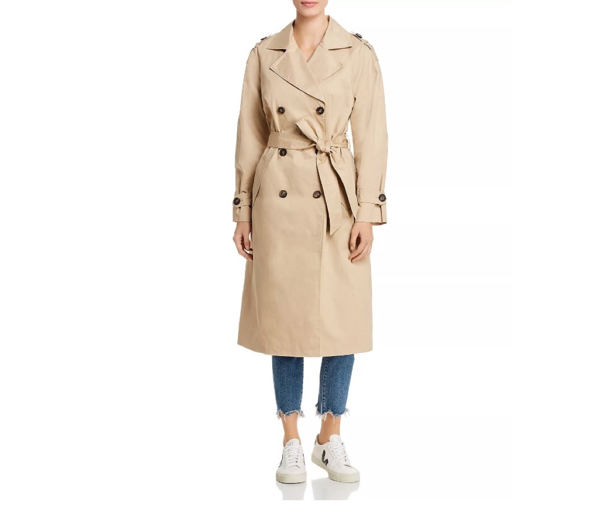 white woman in tan trench coat and cropped jeans