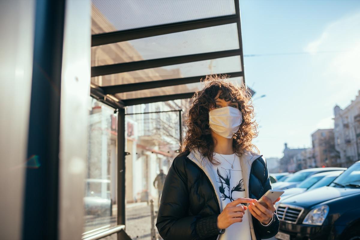 Woman wearing a mask outside