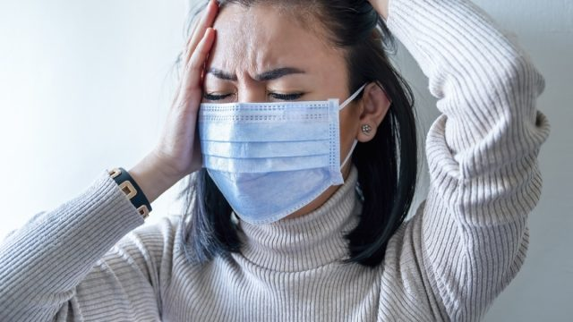 Woman with face mask protection of Coronavirus in human lungs