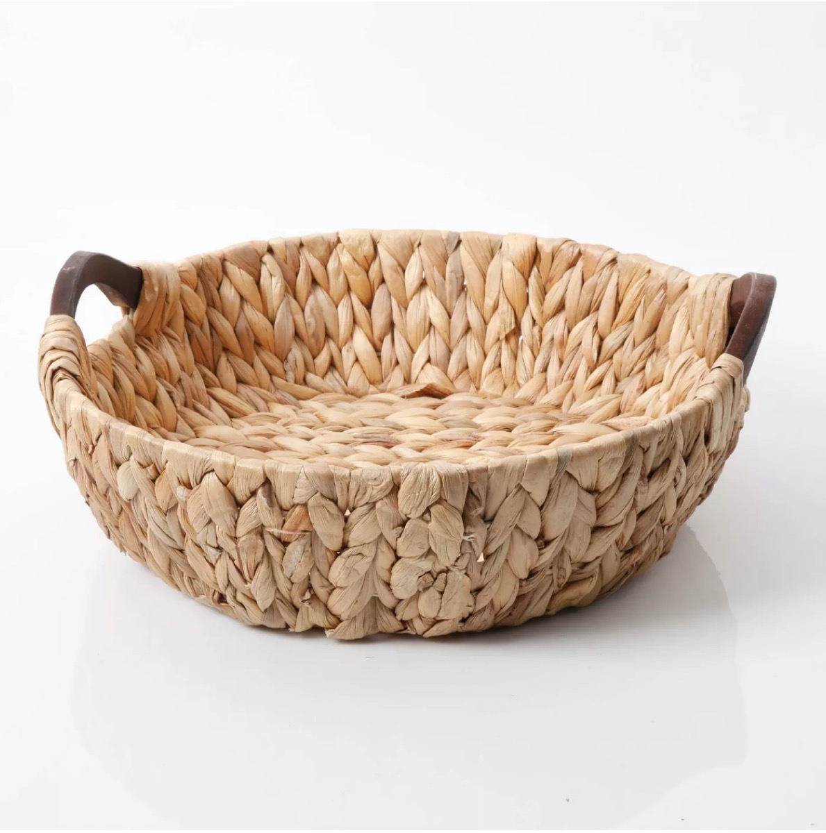 woven basket with leather handles