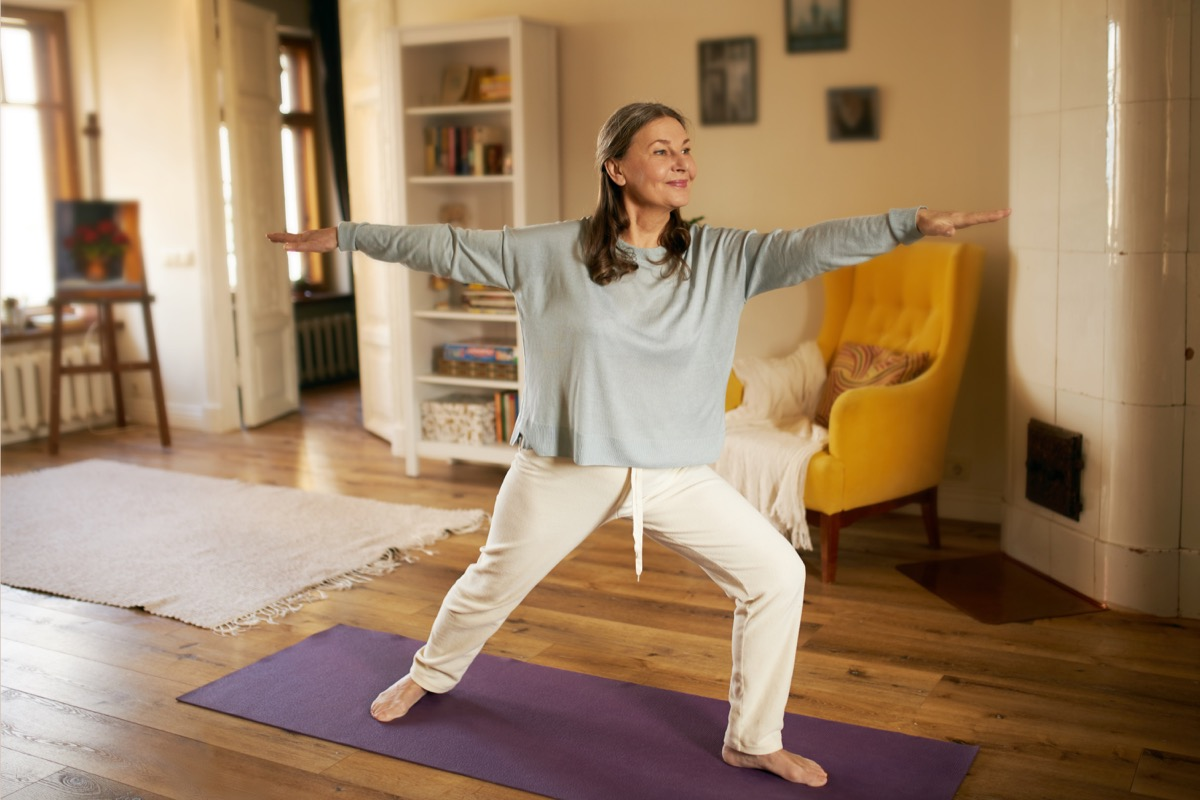 Woman doing yoga at home to reduce anxiety