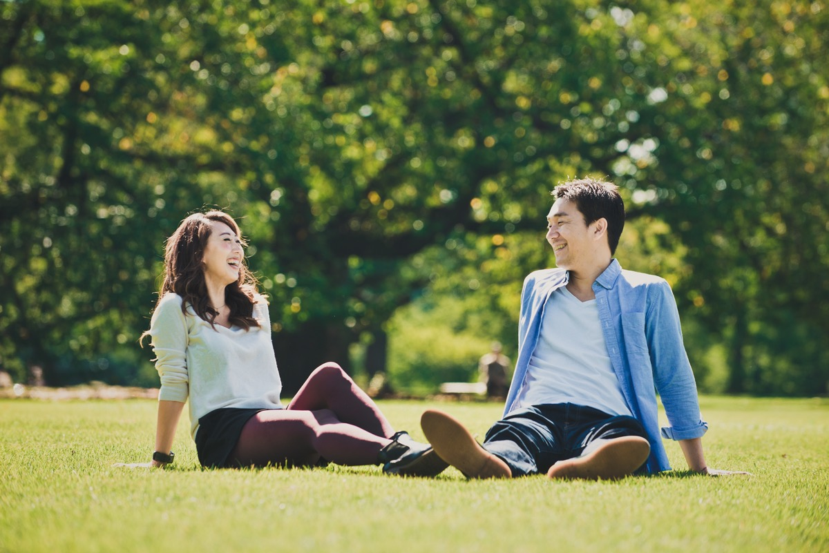 Asian man and woman in park