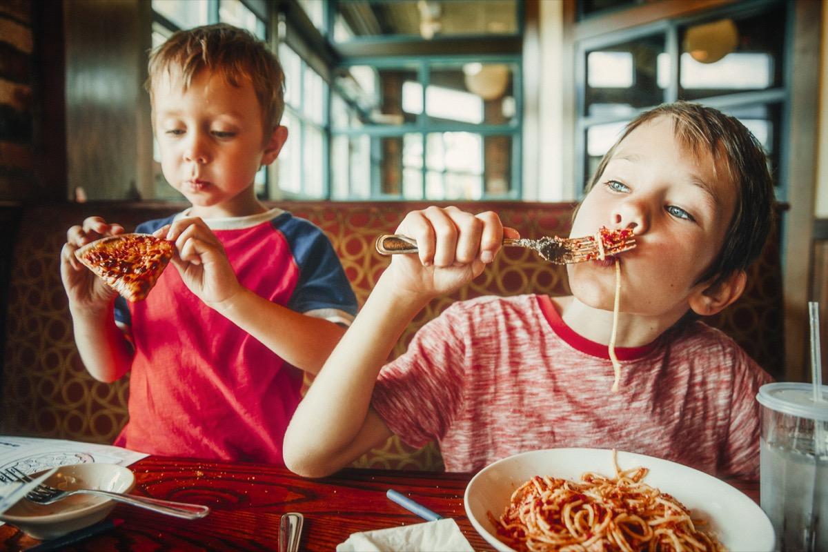 Little boys eating in restaurant
