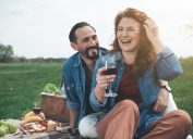 Middle-aged man and woman on picnic date