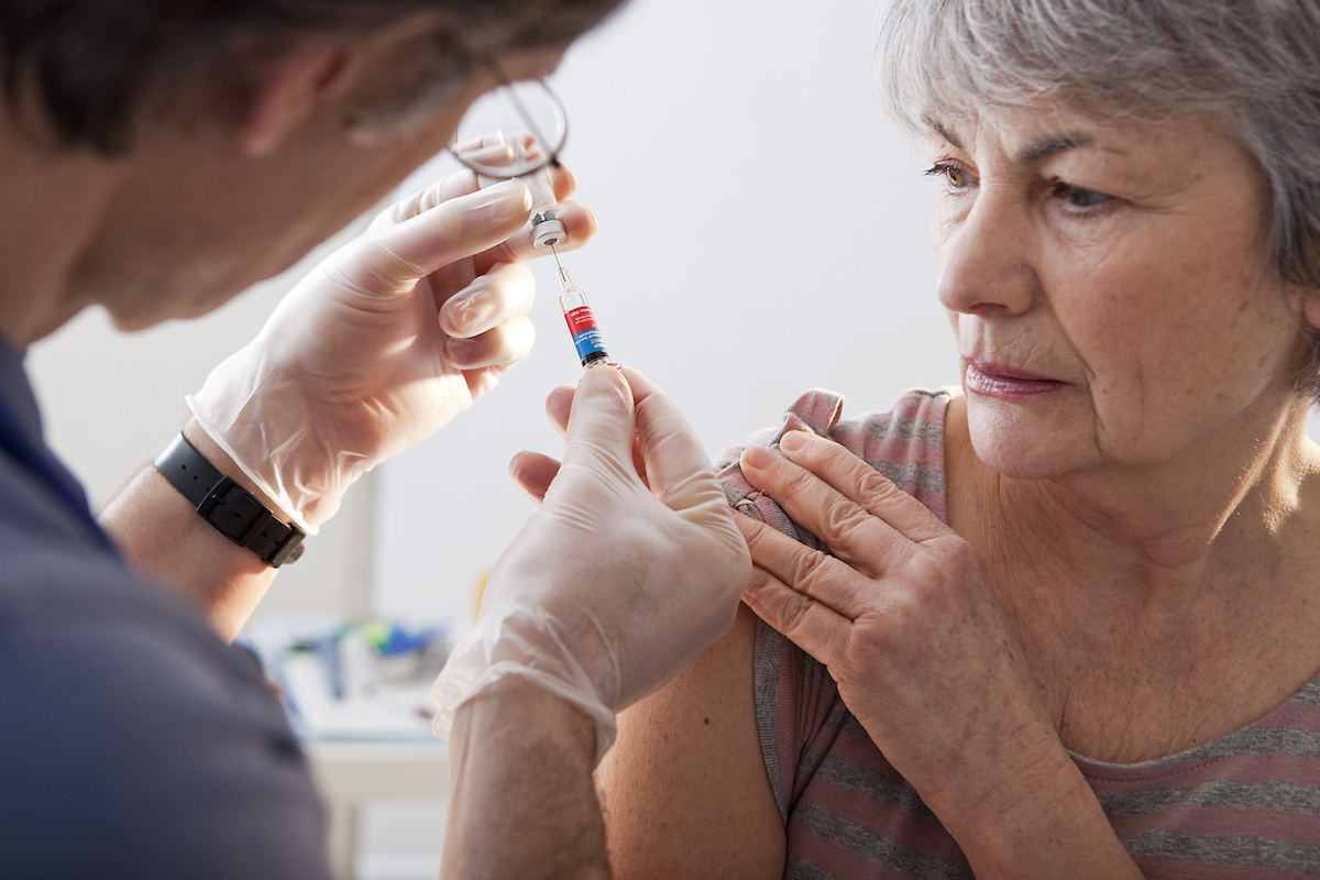 Older woman getting vaccinated