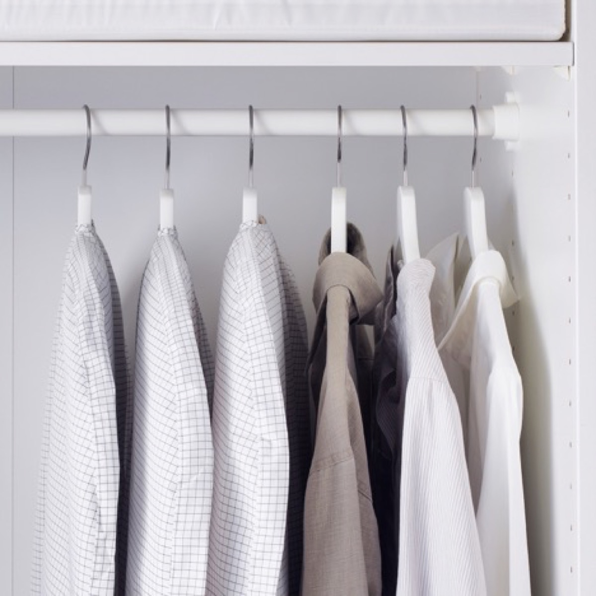 Clothes with covers in closet