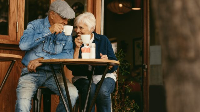 Senior couple drinking coffee at cafe